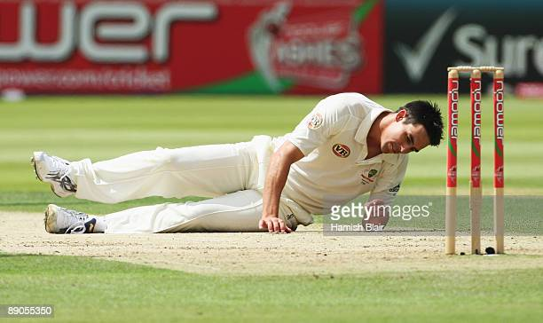 Mitchell Johnson of Australia lies on the ground after failing to stop a shot off his own bowling during day one of the npower 2nd Ashes Test Match...