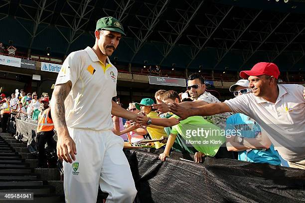 Mitchell Johnson of Australia makes his way onto the field to accept his award for Man of the Match during day four of the First Test match between...