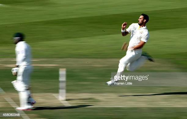 Mitchell Johnson of Australia opens the bowling in the first over during day one of the second test between Pakistan and Australia at Sheikh Zayed...