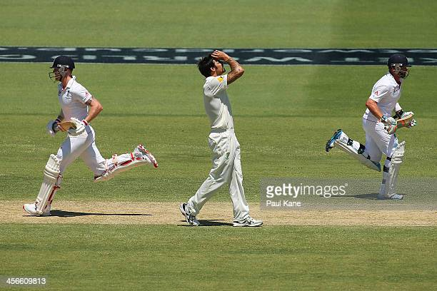 Mitchell Johnson of Australia reacts as Ben Stokes and Ian Bell of England run between wickets during day three of the Third Ashes Test Match between...