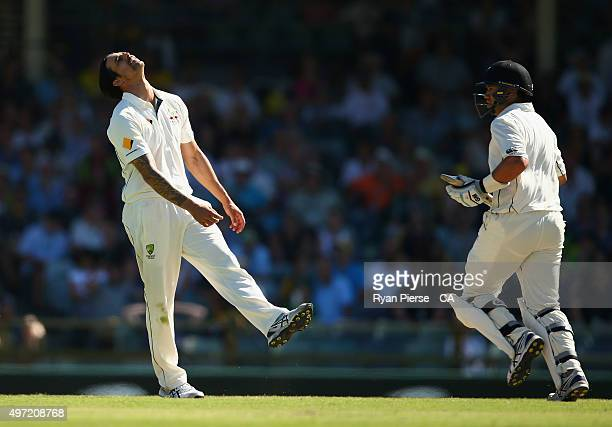 Mitchell Johnson of Australia reacts while bowling during day three of the second Test match between Australia and New Zealand at WACA on November 15...