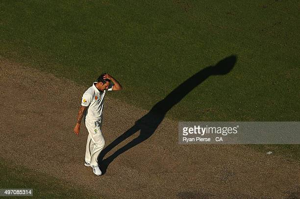 Mitchell Johnson of Australia reacts while bowling during day two of the second Test match between Australia and New Zealand at WACA on November 14...