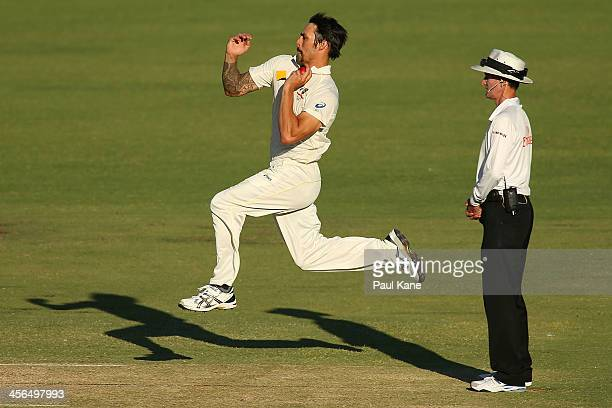 Mitchell Johnson of Australia runs past Umpire Billy Bowden in his delivery stride during day two of the Third Ashes Test Match between Australia and...