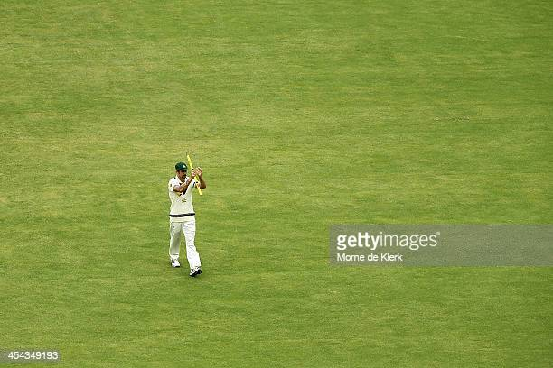 Mitchell Johnson of Australia salutes the crowd after the game was won during day five of Second Ashes Test Match between Australia and England at...