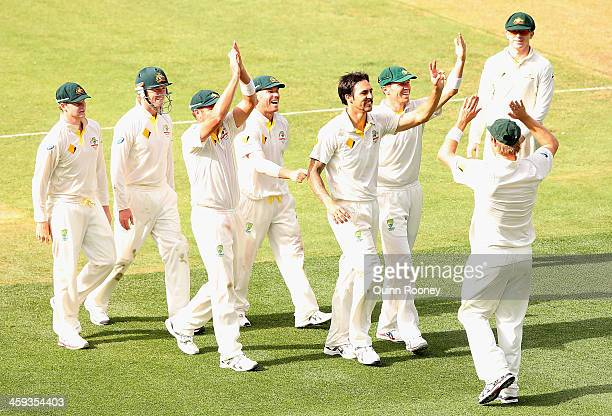 Mitchell Johnson of Australia signals to the Barmy Army after taking the wicket of Jonny Bairstow of England of England during day one of the Fourth...