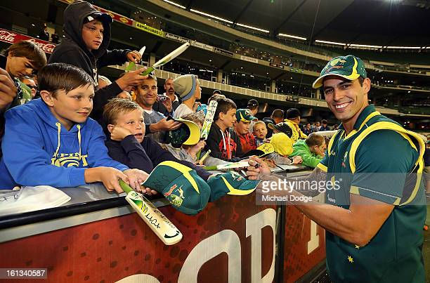 Mitchell Johnson of Australia signs autographs for cricket fans after his win in game five of the Commonwealth Bank International Series between...