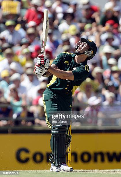 Mitchell Johnson of Australia skies a ball as he is caught in the deep by Matt Prior of England during game seven of the Commonwealth Bank One Day...