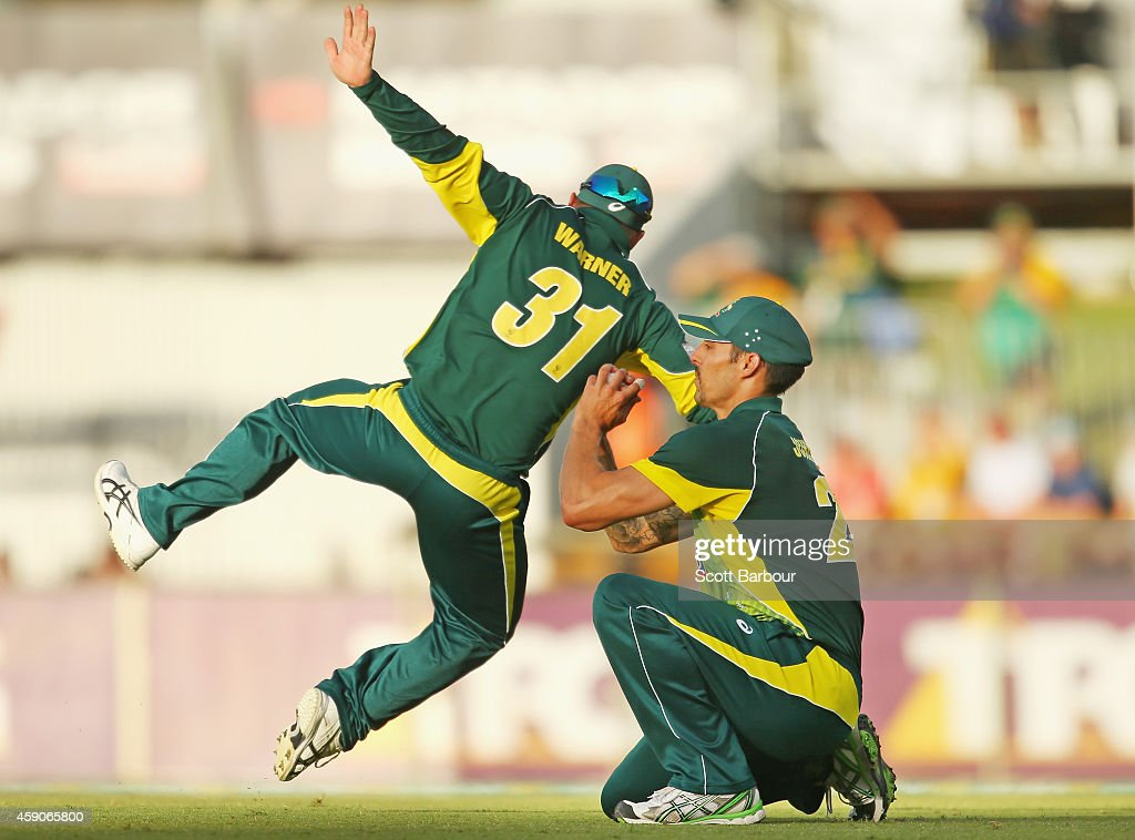 Mitchell Johnson of Australia takes a catch to dismiss Vernon Philander of South Africa as David Warner attempts to catch the ball as well during the One Day International match between Australia and South Africa at WACA on November 16, 2014 in Perth, Australia.