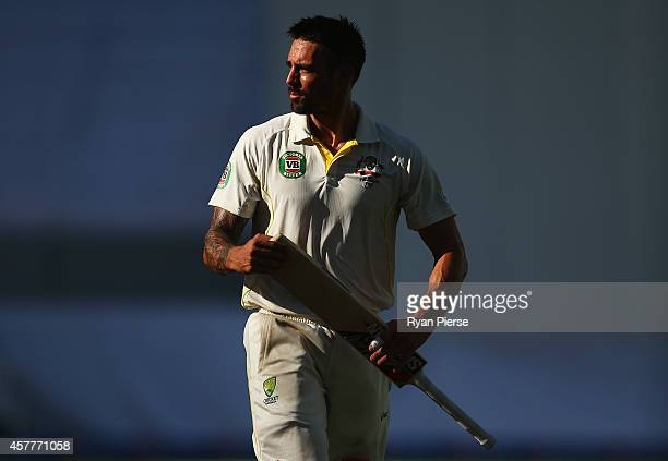 Mitchell Johnson of Australia walks from the field at the tea break during Day Three of the First Test between Pakistan and Australia at Dubai...
