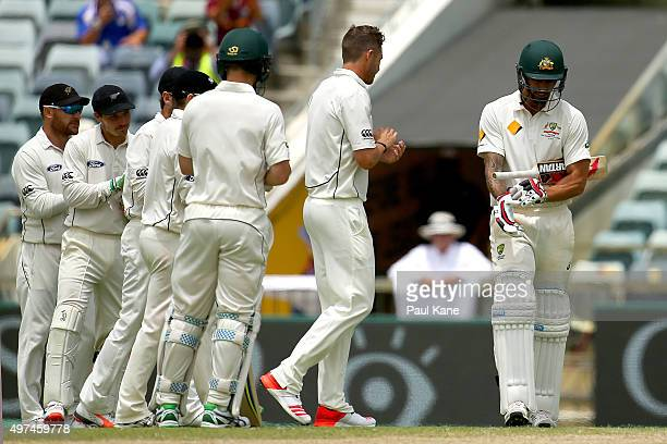 Mitchell Johnson of Australia walks out to bat past a guard of honour by New Zealand players during day five of the second Test match between...