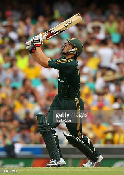 Mitchell Johnson of Australia watches the ball after skying it into the deep during the Third One Day International match between Australia and the...