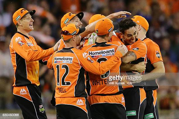 Mitchell Johnson of the Scorchers celebrates after taking his first wicket during the Big Bash League between the Perth Scorchers and Adelaide...