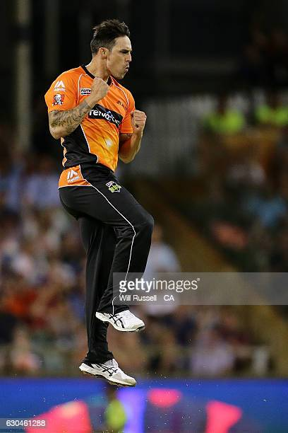 Mitchell Johnson of the Scorchers celebrates after taking the wicket of Brad Hodge of the Strikers during the Big Bash League between the Perth...