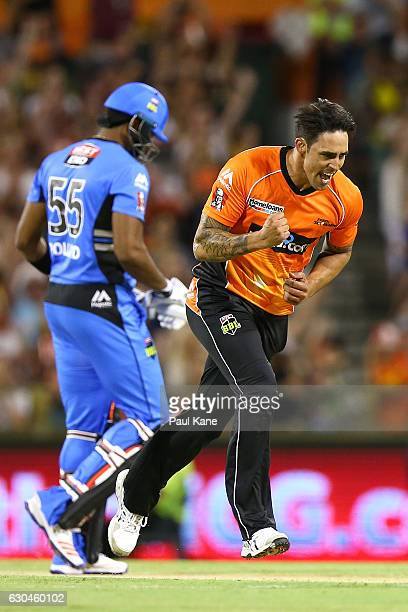 Mitchell Johnson of the Scorchers celebrates the wicket of Kieron Pollard of the Strikersduring the Big Bash League between the Perth Scorchers and...
