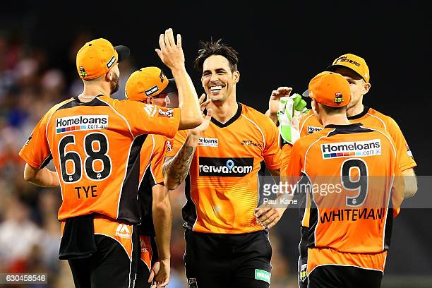 Mitchell Johnson of the Scorchers celebrates the wicket of Michael Neser of the Strikers during the Big Bash League between the Perth Scorchers and...
