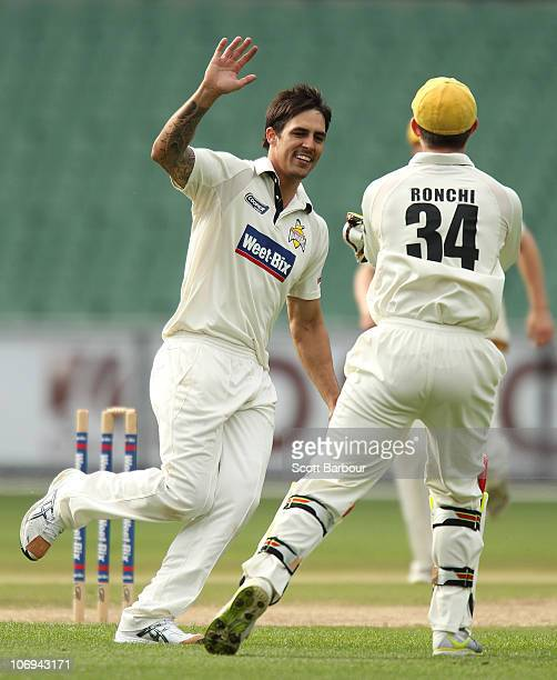 Mitchell Johnson of the Warriors celebrates after running out Rob Quiney of the Bushrangers during day two of the Sheffield Shield match between the...