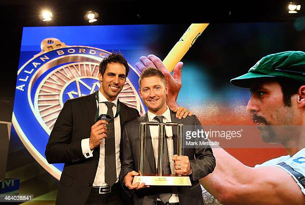 Mitchell Johnson poses with Michael Clarke after winning the Allan Border Medal during the 2014 Allan Border Medal at Doltone House on January 20...