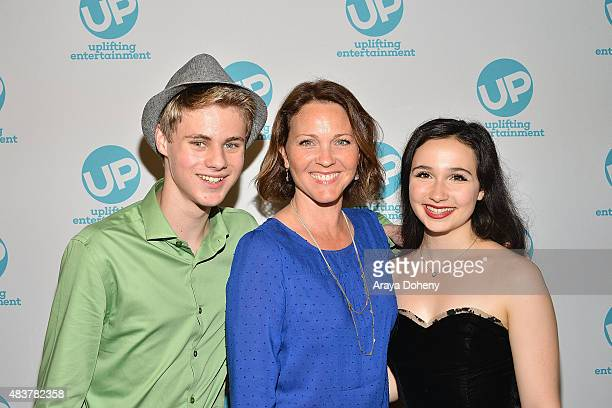 Mitchell Kummen Kelli Williams and Matreya Scarrwener attend the Ties That Bind red carpet premiere party at Pearl's Liquor Bar on August 12 2015 in...