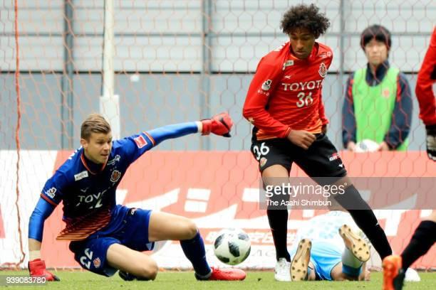 Mitchell Langerak and Rocha of Nagoya Grampus in action during the JLeague J1 match between Nagoya Grampus and Jubilo Iwata at Toyota Stadium on...