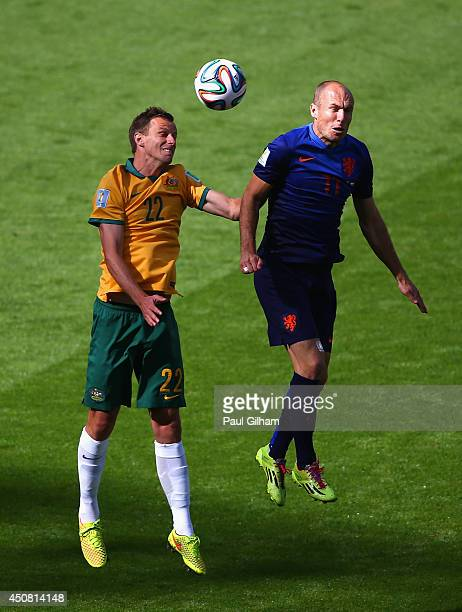 Mitchell Langerak of Australia and Arjen Robben of the Netherlands go up for a header during the 2014 FIFA World Cup Brazil Group B match between...