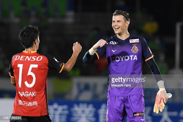 Mitchell Langerak of Nagoya Grampus celebrates the win after the J.League Meiji Yasuda J1 match between Shonan Bellmare and Nagoya Grampus at the...