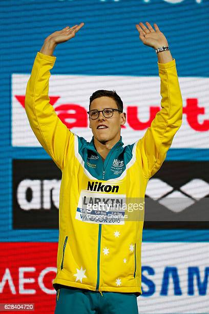 Mitchell Larkin of Australia celebrates his gold medal in the 100m Backstroke on day two of the 13th FINA World Swimming Championships at the WFCU...