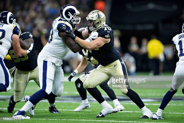 Mitchell Loewen of the New Orleans Saints is blocked by Cornelius Lucas of the Los Angeles Rams at MercedesBenz Superdome during week 4 of the...