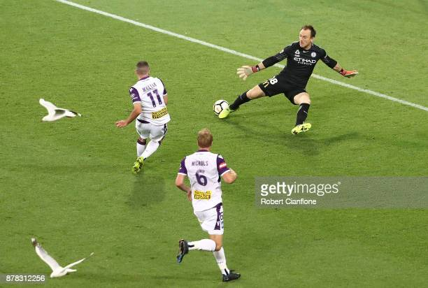 Mitchell Mallia of the Glory gets the ball past City goalkeeper Eugene Galekovic to score during the round eight ALeague match between Melbourne City...