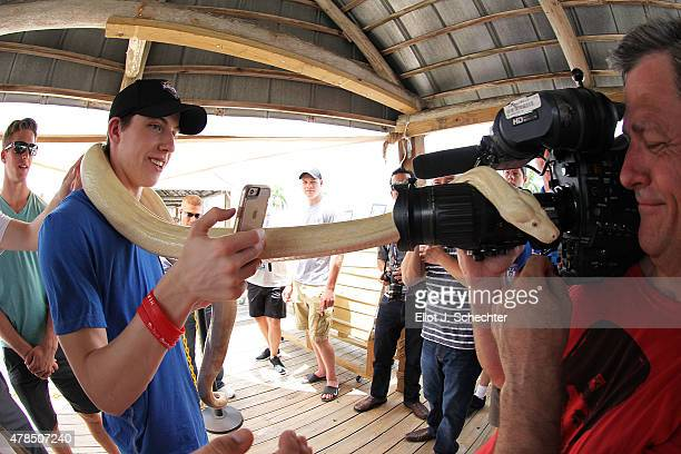 Mitchell Marner a 2015 NHL top Draft Prospect takes a selfie holding a ball python while on a tour of the Florida Everglades on June 25 2015 near...