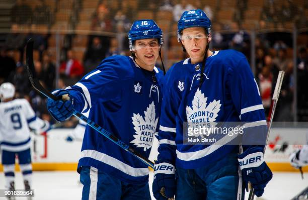 Mitchell Marner and Connor Brown of the Toronto Maple Leafs wear jersey's honouring Leafs legend Johnny Bower during warmup before facing the Tampa...