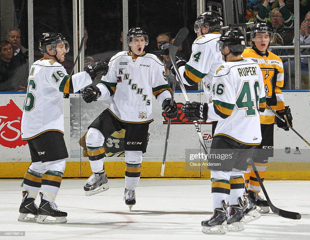 Mitchell Marner #93 of the London Knights celebrates teammate Michael McCarron's goal against the Kingston Frontenacs in an OHL game at Budweiser Gardens on November 29, 2014 in London, Ontario, Canada.