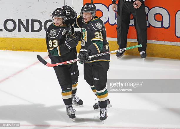 Mitchell Marner of the London Knights congratulates teammate Julius Bergman on his goal against the Oshawa Generals during an OHL game at Budweiser...