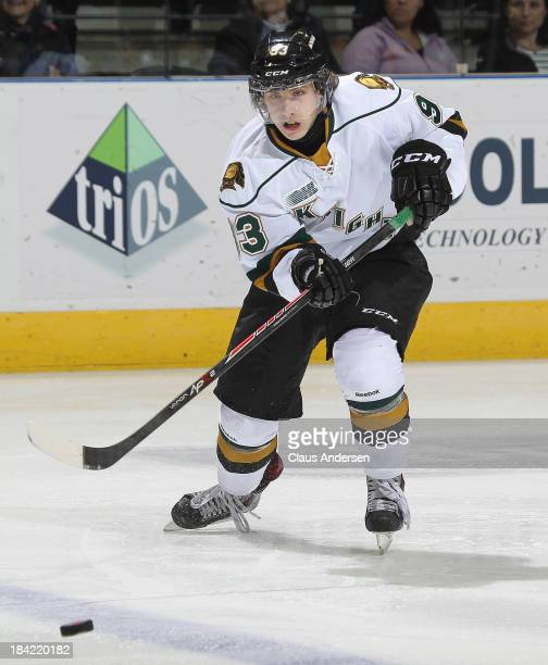Mitchell Marner of the London Knights fires a pass against the Belleville Bulls during an OHL game at the Budweiser Gardens on October 11 2013 in...
