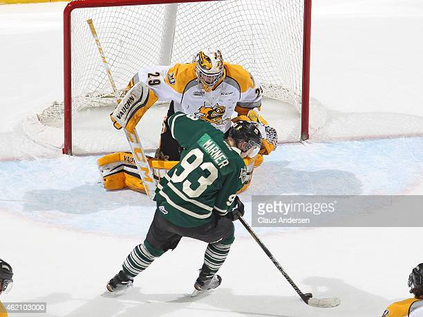 Mitchell Marner of the London Knights gets set to get a shot away on Taylor Dupuis of the Sarnia Sting in an OHL game at Budweiser Gardens on January...