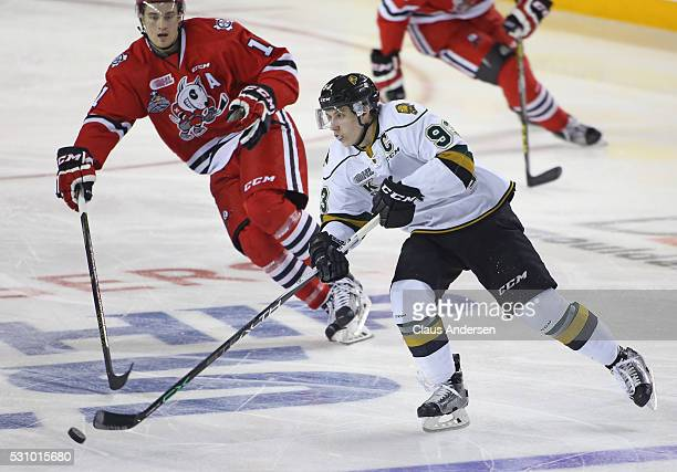 Mitchell Marner of the London Knights makes a pass away from a checking Brendan Perlini of the Niagara IceDogs during Game Four of the OHL...