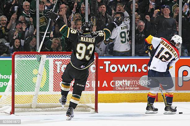 Mitchell Marner of the London Knights starts the victory celebration with a late empty net goal against the Erie Otters in game four of the OHL...