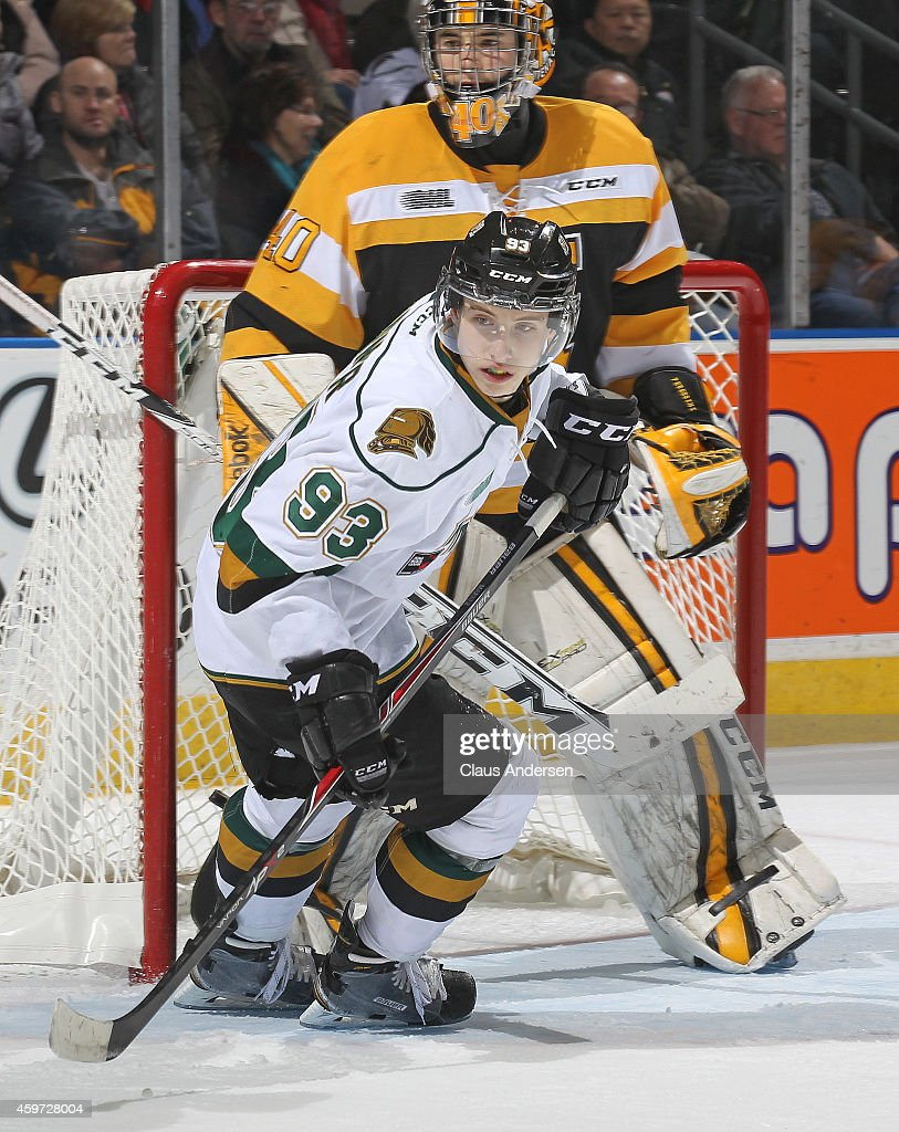 Mitchell Marner #93 of the London Knights turns in front of Lucas Peressini #40 of the Kingston Frontenacs in an OHL game at Budweiser Gardens on November 29, 2014 in London, Ontario, Canada. The Frontenacs defeated the Knights 3-2 in an overtime shoot-out.