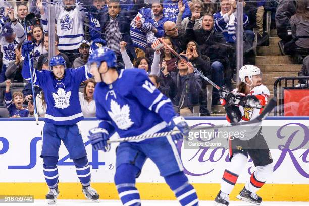 TORONTO ON FEBRUARY 10 Mitchell Marner of the Maple Leafs celebrates the goal by Patrick Marleau as Erik Karlsson of the Senators smashes his stick...