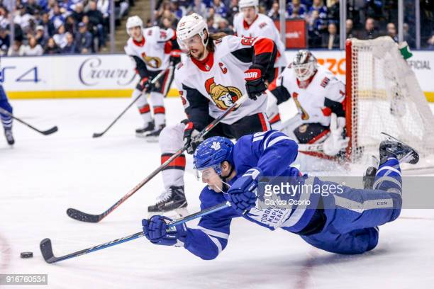 TORONTO ON FEBRUARY 10 Mitchell Marner of the Maple Leafs tries to get a puck past Senators defensemen Erik Karlsson during the 3rd period of NHL...