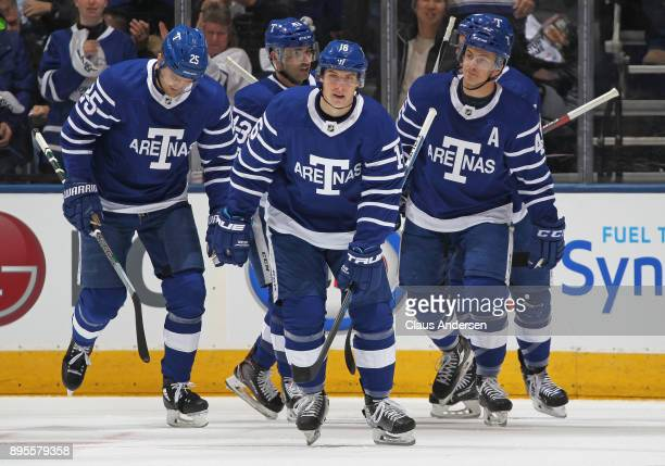 Mitchell Marner of the Toronto Maple Leafs celebrates a goal against the Carolina Hurricanes during an NHL game at the Air Canada Centre on December...