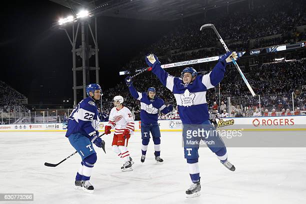 Mitchell Marner of the Toronto Maple Leafs celebrates his goal in front of teammates Nikita Zaitsev and James van Riemsdyk and Brendan Smith of the...