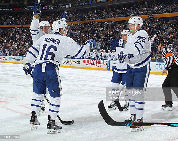 Mitchell Marner of the Toronto Maple Leafs celebrates his second period goal with teammate James van Riemsdyk during an NHL game against the Buffalo...