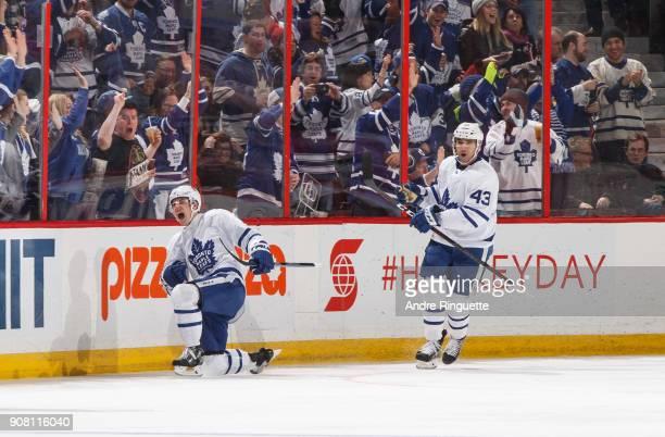 Mitchell Marner of the Toronto Maple Leafs celebrates his third period goal against the Ottawa Senators with teammate Nazem Kadri at Canadian Tire...