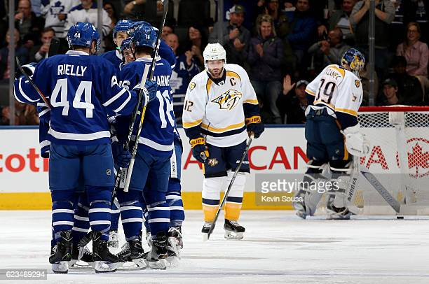 Mitchell Marner of the Toronto Maple Leafs is congratulated on his goal as Mike Fisher of the Nashville Predators skates away and Nashville Predators...