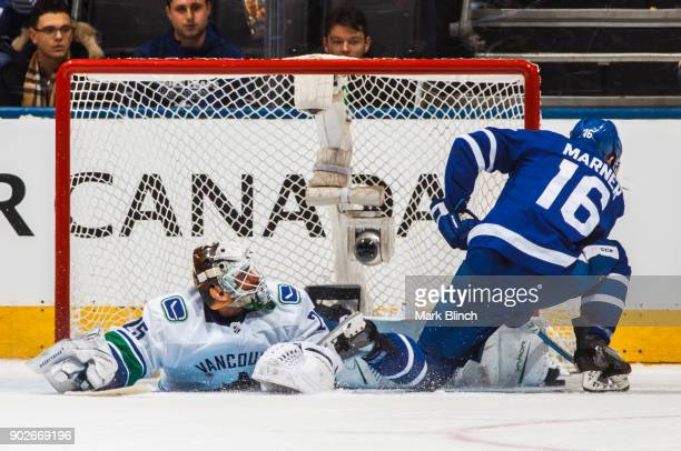 Mitchell Marner of the Toronto Maple Leafs is stopped by Jacob Markstrom of the Vancouver Canucks in the shootout at the Air Canada Centre on January...