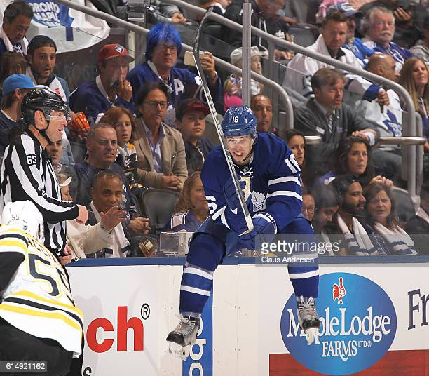 Mitchell Marner of the Toronto Maple Leafs jumps to get out of the way of an incoming puck against the Boston Bruins during an NHL game on October 15...