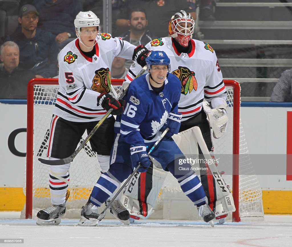 Mitchell Marner #16 of the Toronto Maple Leafs looks for a puck to tip in front of Connor Murphy #5 and Anton Forsberg #31 the Chicago Blackhawks in an NHL game at the Air Canada Centre on October 9, 2017 in Toronto, Ontario. The Maple Leafs defeated the Blackhawks 4-3 in overtime