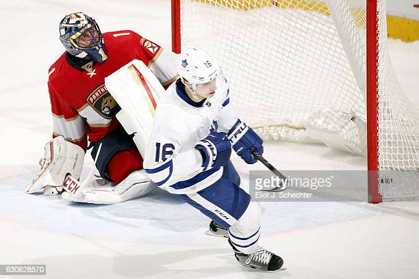 Mitchell Marner of the Toronto Maple Leafs shoots and scores in a shoot out for the win against Goaltender Roberto Luongo of the Florida Panthers at...