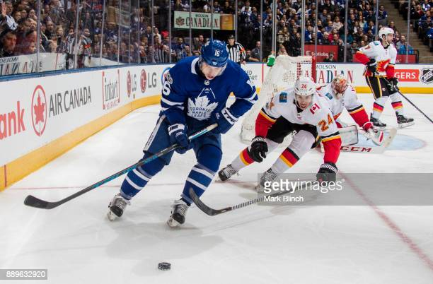 Mitchell Marner of the Toronto Maple Leafs skates against Travis Hamonic of the Calgary Flames during the first period at the Air Canada Centre on...