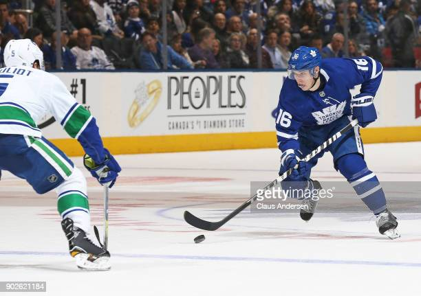 Mitchell Marner of the Toronto Maple Leafs skates with the puck against the Vancouver Canucks during an NHL game at the Air Canada Centre on January...